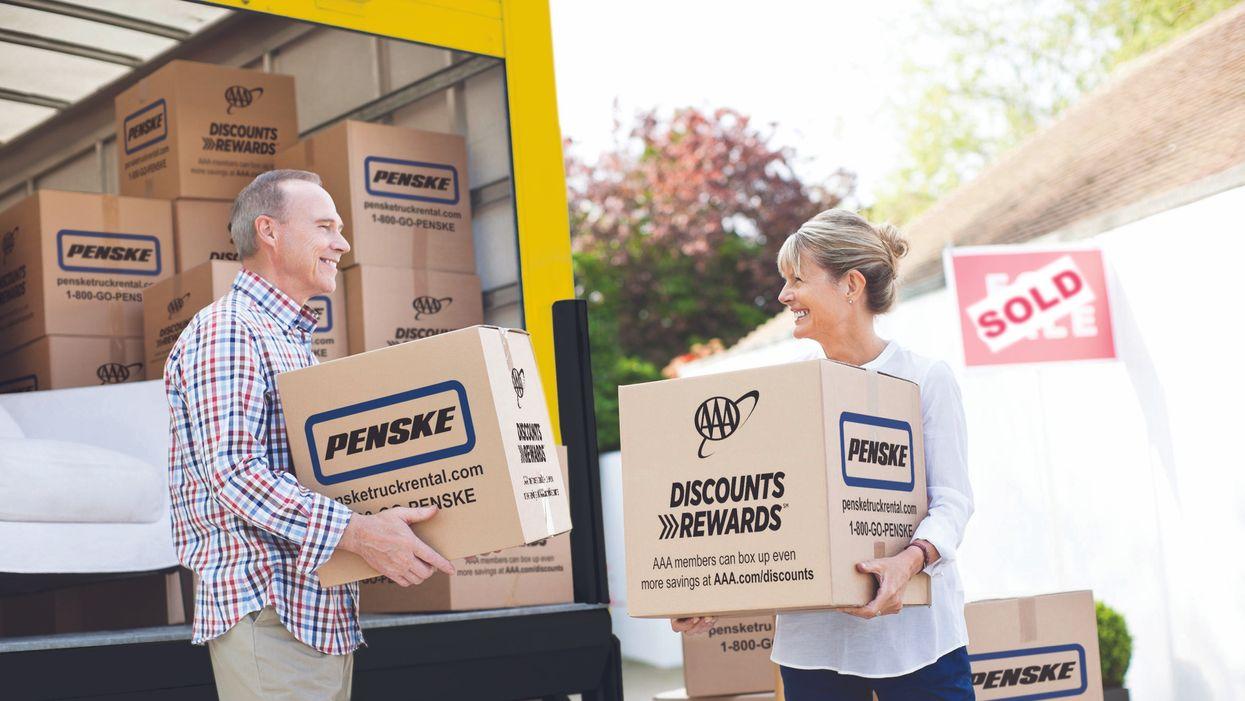 Couple unloading Penske truck
